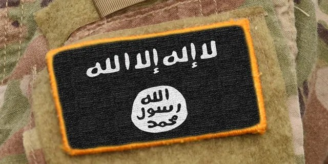 Flag of Islamic State of Iraq and the Levant on military uniforms. Flag of Islamic State of Iraq and the Levant on soldier arm. (collage).