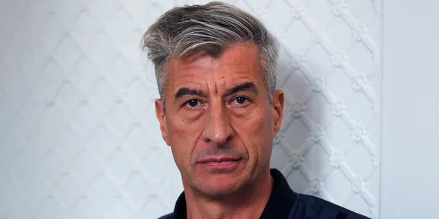 Italian artist Maurizio Cattelan created the banana duct-taped to a wall art piece that sold for $120,000. (Reuters, File)