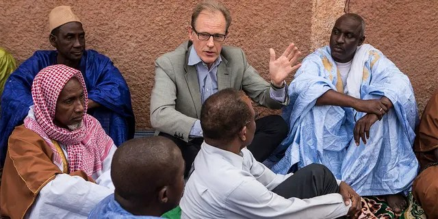 In this Nov. 3, 2017, photo provided by the United Nations, Andrew Gilmour, center, assistant secretary-general for human rights, meets with Peul religious leaders from Mopti to discuss human rights issues and the security situation in the region in Mali. (Harandane Dicko/United Nations via AP)