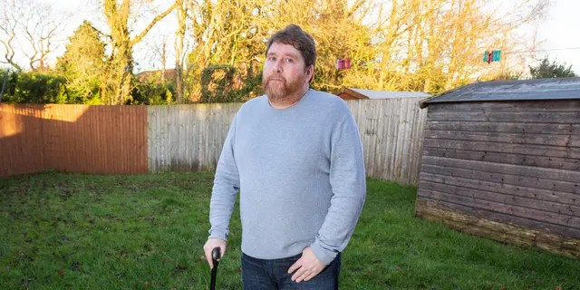 Stuart Clegg, 53, pictured at his home in Lancashire. (SWNS)