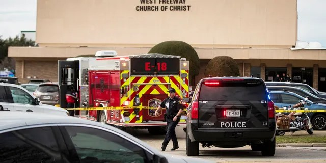 Police and fire departments surround the scene of a shooting at West Freeway Church of Christ in White Settlement, Texas, Sunday, Dec. 29, 2019.