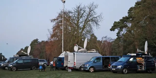 Media prepares in the early morning at the entrance of the castle in Sandringham, England, Monday, Jan. 13, 2020.