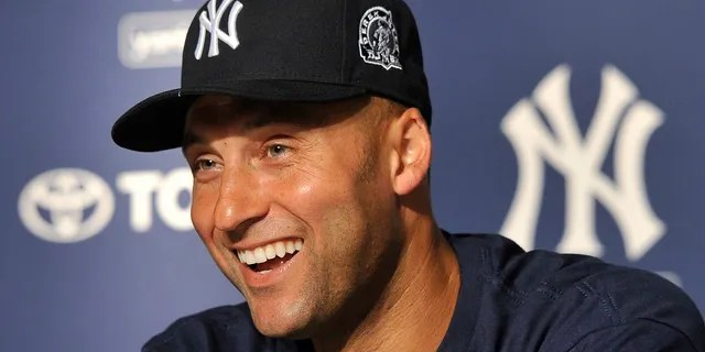 New York Yankees' Derek Jeter smiles as he speaks about his 3,000th career hit at a press conference after a baseball game against the Tampa Bay Rays, at Yankee Stadium in New York.