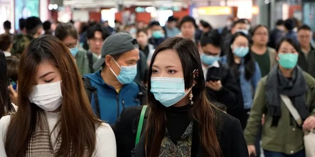 Passengers wear masks to prevent an outbreak of a new coronavirus in a subway station, in Hong Kong. The first case of coronavirus in Macao was confirmed on Wednesday, according to state broadcaster CCTV. The infected person, a 52-year-old woman, was a traveller from Wuhan. (AP Photo/Kin Cheung)