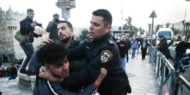 Israeli border police arrests a Palestinian ahead of a protest against Middle East peace plan announced Tuesday by US President Donald Trump, which strongly favors Israel, in Jerusalem, Wednesday, Jan 29, 2020.