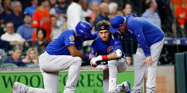 Albert Almora Jr. #5 of the Chicago Cubs is comforted by manager Joe Maddon #70 and Jason Heyward #22 after a young child was injured on foul ball off his bat in the fourth inning against the Houston Astros at Minute Maid Park on May 29, 2019 in Houston, Texas. (Photo by Bob Levey/Getty Images)
