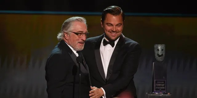 Leonardo DiCaprio, right, presents the lifetime achievement award to Robert De Niro at the 26th annual Screen Actors Guild Awards at the Shrine Auditorium & Expo Hall on Sunday, Jan. 19, 2020, in Los Angeles.