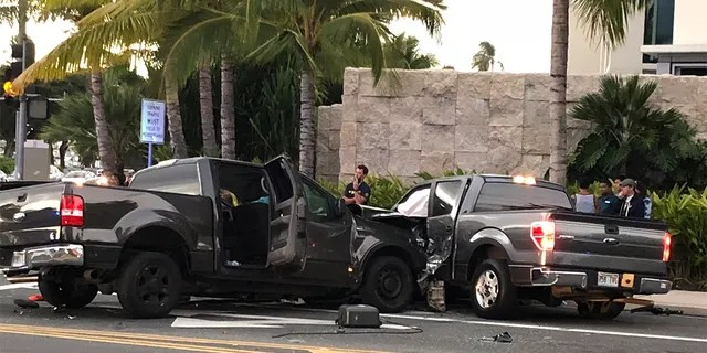 FILE - This Monday, Jan. 28, 2019 file photo shows the scene of a multiple vehicle accident involving two trucks and a bicyclist in Honolulu. Police say a suspected drunk driver slammed into a crowded Honolulu intersection, killing two pedestrians and a bicyclist and injuring five people including himself. (Cindy Ellen Russell/Honolulu Star-Advertiser via AP)