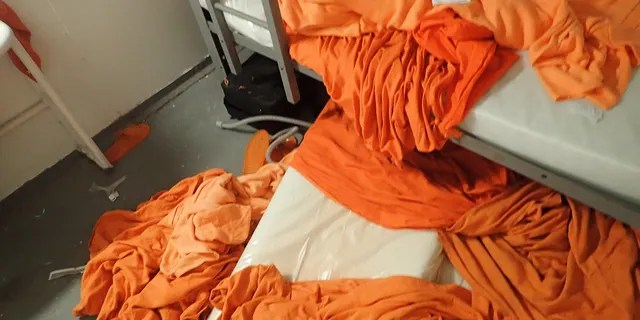 Sheets are seen strewn across the floor inside Epstein's cell.