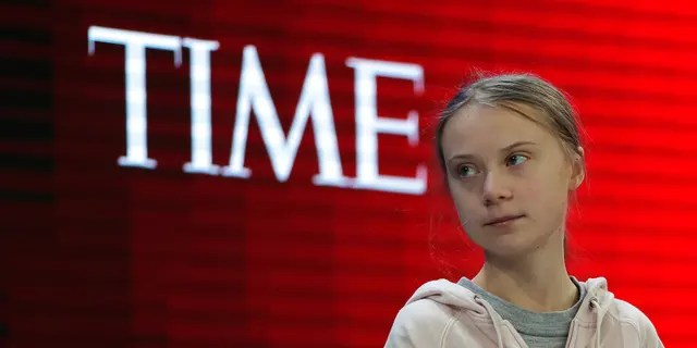 Swedish environmental activist Greta Thunberg takes her seat prior to the opening session of the World Economic Forum in Davos, Switzerland. (AP Photo/Markus Schreiber)
