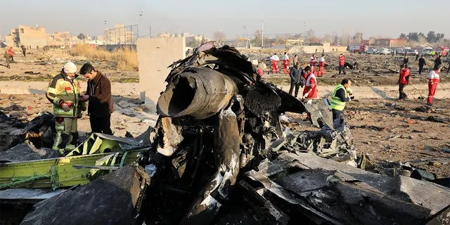 "FILE - In this Wednesday, Jan. 8, 2020 file photo, debris at the scene where a Ukrainian plane crashed in Shahedshahr southwest of the capital Tehran, Iran. Iran announced Saturday, Jan. 11, that its military ""unintentionally"" shot down the Ukrainian jetliner that crashed earlier this week, killing all 176 aboard, after the government had repeatedly denied Western accusations that it was responsible. (AP Photo/Ebrahim Noroozi, File)"