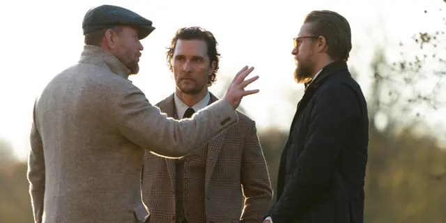 (L- R): Guy Ritchie, Matthew McConaughey, and Charlie Hunnam filming a scene from 'The Gentlemen'