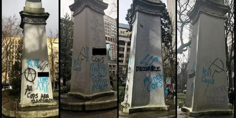 Messages can be seen spray-painted on a war memorial in Portland, Ore. after a demonstration on Saturday. (Portland Police Bureau)