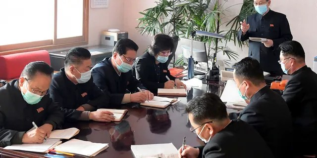 In this undated photo distributed by the North Korean government, North Korean Premier Kim Jae Ryon, right top, has a meeting at the emergency anti-epidemic headquarter in Pyongyang, North Korea. The content of this image is as provided and cannot be independently verified.