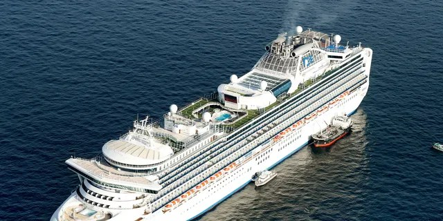 Cruise ship Diamond Princess is anchored off the shore of Yokohama, south of Tokyo, Wednesday, Feb. 5, 2020. Japan said Wednesday 10 people on the cruise ship have tested positive for a new virus and were being taken to hospitals. (Hiroko Harima/Kyodo News via AP)