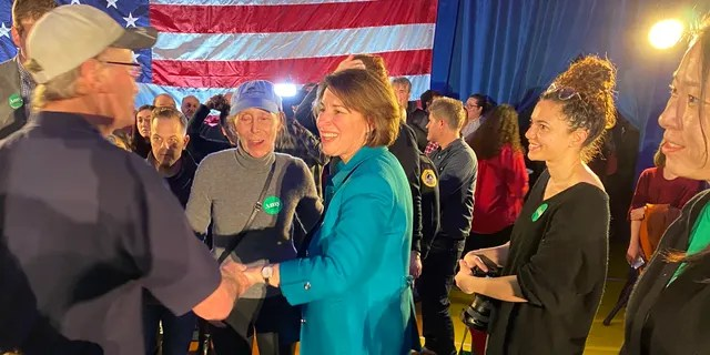 Democratic presidential candidate Sen. Amy Klobuchar of Minnesota shakes hands with voters after a rally in Des Moines, IA on Feb. 1, 2020