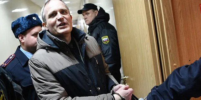 Dennis Christensen, a Danish Jehovah's Witness accused of extremism, is escorted into a courtroom to hear his verdict in the town of Oryol on February 6, 2019. (MLADEN ANTONOV/AFP via Getty Images)