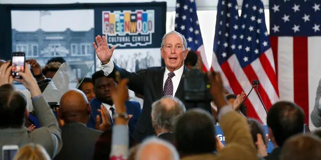 FILE - In this Sunday, Jan. 19, 2020, file photo, Democratic presidential candidate and former New York City Mayor Mike Bloomberg waves to the crowd at the conclusion of his speech at the Greenwood Cultural Center in Tulsa, Okla. Bloomberg spent heavily on advertising and nearly two dozen field staffers in Oklahoma and has made multiple campaign stops in the Sooner State. (AP Photo/Sue Ogrocki, File)