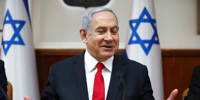 Israeli Prime Minister Benjamin Netanyahu chairs the weekly cabinet meeting in Jerusalem, Sunday, March. 8, 2020.
