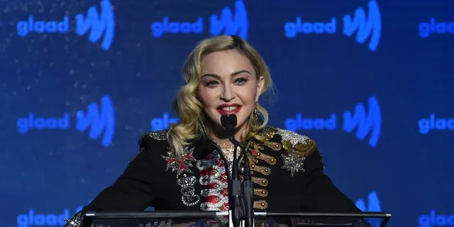 FILE - In this May 4, 2019, file photo, honoree Madonna accepts the advocate for change award at the 30th annual GLAAD Media Awards at the New York Hilton Midtown in New York. Madonna has canceled the last two stops of her latest tour in France after the country said it was banning events of more than 1,000 people to limit the spread of the coronavirus.
