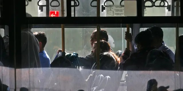 Passengers sit on a bus at the main bus station in Guatemala City, Friday, March 13, 2020. Authorities in Guatemala, Uruguay and Venezuela confirmed their first cases of the new coronavirus on Friday, while Argentina announced its second death linked to the global pandemic, and some countries such as El Salvador and Ecuador reinforced measures to contain the spread of the virus. For most people, the new coronavirus causes only mild or moderate symptoms. For some it can cause more severe illness. (AP Photo/Moises Castillo)