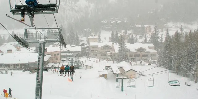 In this Feb. 21, 2008, file photo, skiers ride up Al's Run lift at the Taos Ski Valley, in Taos County, N.M. Some resorts are closing enclosed gondolas or aerial trams while others are encouraging skiers to ride lifts with only people they know as they adhere to social distancing guidelines. (AP Photo/Albuquerque Journal, File)