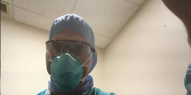 Dr. Christian DiPaola always wears full protective gear in his Massachusetts hospital, going much further than CDC guidelines.