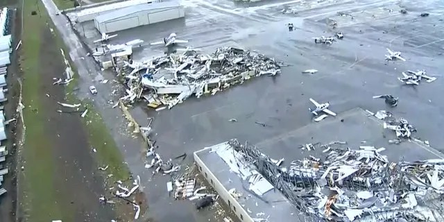 """Damaged aircraft can be seen at John C. Tune Airport, Nashville International's sister airport in West Nashville, which """"sustained significant damage due to severe weather."""""""