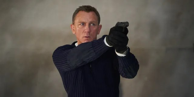 James Bond (Daniel Craig) prepares to shoot in 'No Time to Die.'