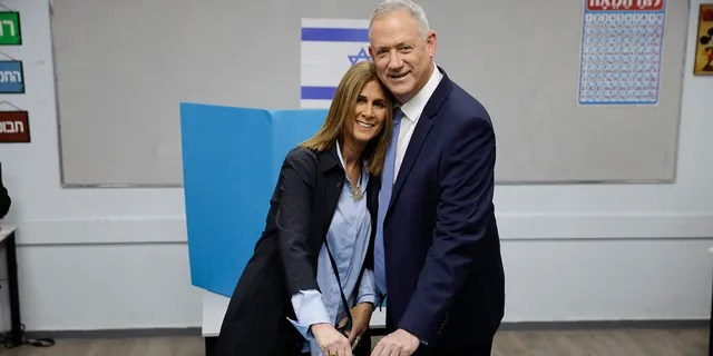 Gantz and his wife Revital vote in Rosh Haayin, Israel, on Monday in the country's third general election in less than a year. (AP Photo/Sebastian Scheiner)