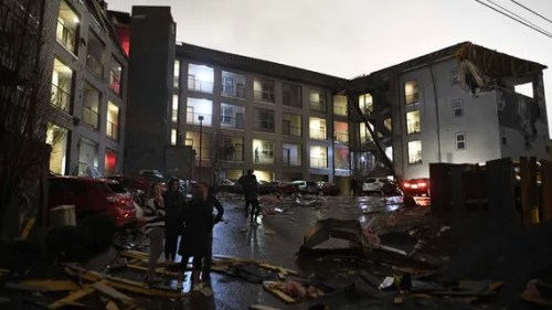Debris is scattered across the parking lot of a damaged apartment building after a tornado hit Nashville in the early morning hours of Tuesday, March 3, 2020.