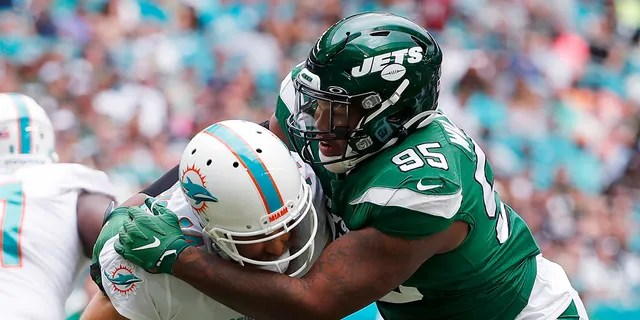 In this Nov. 3, 2019, file photo, New York Jets defensive tackle Quinnen Williams (95) sacks Miami Dolphins quarterback Ryan Fitzpatrick during the first half of an NFL football game in Miami Gardens, Fla. (AP Photo/Wilfredo Lee, File)