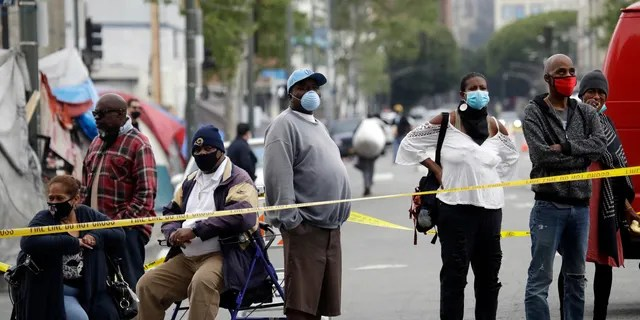 People queue to get tested for COVID-19 in the Skid Row neighborhood on Monday April 20 in Los Angeles. The coronavirus epidemic in Los Angeles County has infected approximately 28 to 55 times more people than expected, according to a report released Monday. (Photo AP / Marcio Jose Sanchez)