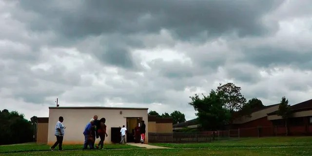 In this April 29, 2014 file image from a video, people enter a storm shelter during a tornado in Tuscaloosa, Ala.