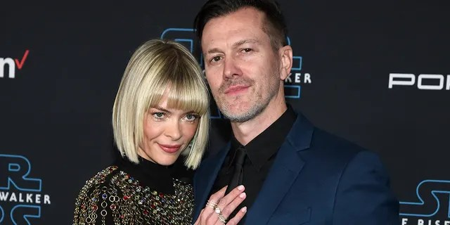 Actress Jaime King (L) and director/producer Kyle Newman (R) attend the premiere of Disney's
