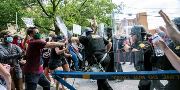 Protesters and police clash in Columbia, SC, Sunday.  People protested the police brutality caused by the death of George Floyd at the hands of the police in Minneapolis on May 25 (Jason Lee / The Sun News via AP)