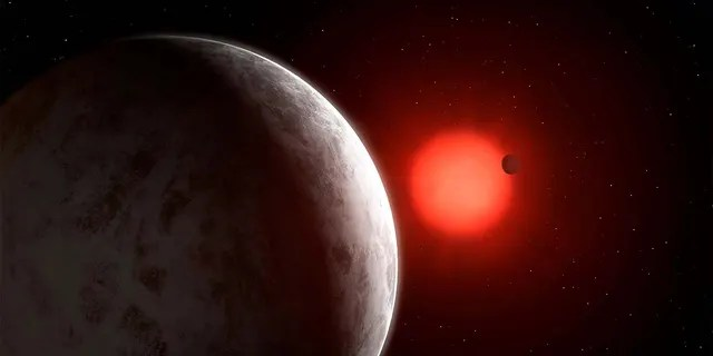 The multiplanetary system of newly discovered super-Earths orbiting nearby red dwarf star Gliese 887 is seen in this artist's impression. Mark Garlick/Handout via REUTERS.