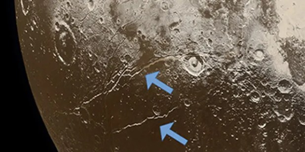 Extensive faults (arrows) on Pluto's surface indicate the expansion of the dwarf planet's icy crust, attributed to the freezing of a subsurface ocean.  (Credit: NASA / Johns Hopkins University Applied Physics Laboratory / Southwest Research Institute / Alex Parker)