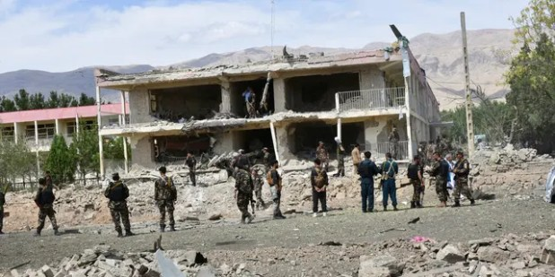 Officials said Afghan security personnel inspected the site of a car bomb blast at an intelligence complex in Aybak, the capital of Samangan province in northern Afghanistan.  Taliban rebels carried out a complex attack on the complex that began with suicide bombings.  (AP photo)