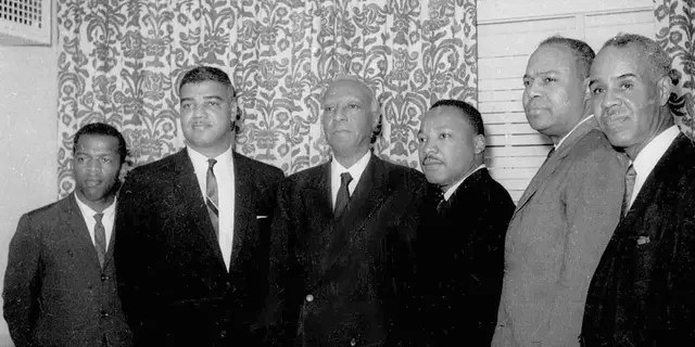 On this July 2, 1963, file photo, six leaders of the nation's largest black civil rights organizations posed at the Roosevelt Hotel in New York.  From left: John Lewis, chairman of the Student Nonviolence Coordination Committee;  Whitney Young, Urban League National Director;  a.  Philip Randolph, president of the Negro American Labor Council;  Martin Luther King Jr., president of the Southern Christian Leadership Conference;  James Farmer, Congress of Racial Equity Director;  And Roy Wilkins, executive secretary of the National Association for the Advancement of Colored People.  (AP Photo / Harry Harris, File)
