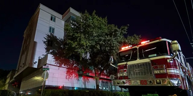 A firetruck is positioned outside the Chinese Consulate Wednesday, July 22, 2020, in Houston. Authorities responded to reports of a fire at the consulate. Witnesses said that people were burning paper in what appeared to be trash cans, according to police. China says the U.S. has ordered it to close its consulate in Houston in what it called a provocation that violates international law. (AP Photo/David J. Phillip)