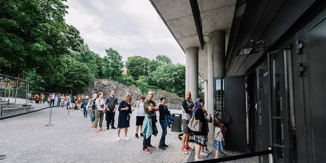People line up to visit the Vasa Museum in Stockholm on July 15, 2020 the day it reopens amid the novel coronavirus pandemic.  (STINA STJERNKVIST / TT News Agency / AFP via Getty Images)