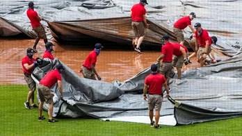 In DC, city of gridlock, tarp stymies Nationals grounds crew