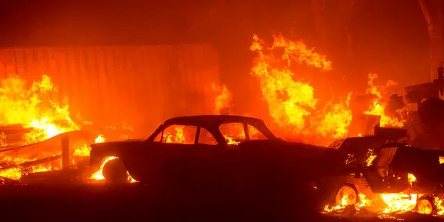 A vehicle burns in the Lake Hughes fire in Angeles National Forest on Wednesday, Aug. 12, 2020, north of Santa Clarita, Calif.