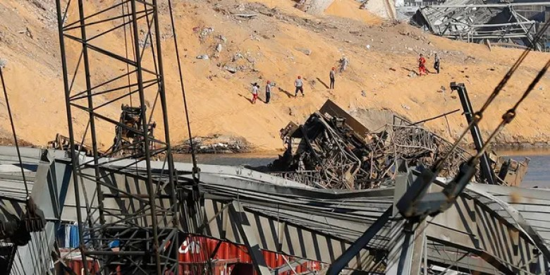 Rescue workers search for victims at the scene of Tuesday's massive explosion at the seaport in Beirut, Lebanon, Thursday, Aug. 6, 2020. (AP Photo/Hussein Malla)