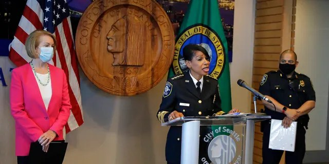 Seattle Police Chief Carmen Best, center, speaks as Seattle Mayor Jenny Durkan, left, and Deputy Police Chief Adrian Diaz, right, look on during a news conference, Tuesday, Aug. 11, 2020, in Seattle.