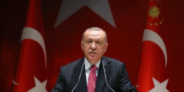 Turkish President Recep Tayyip Erdogan addresses his party members in Ankara, Turkey, Thursday, August 13, 2020.
