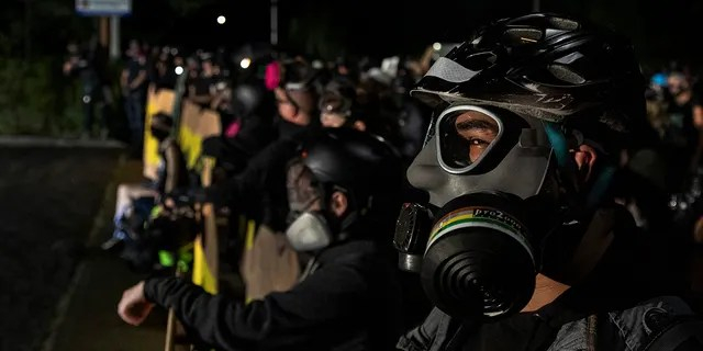 Protesters are seen during a standoff at a Portland police precinct in Portland, Oregon on August 15, 2020. (Paula Bronstein/Getty Images)