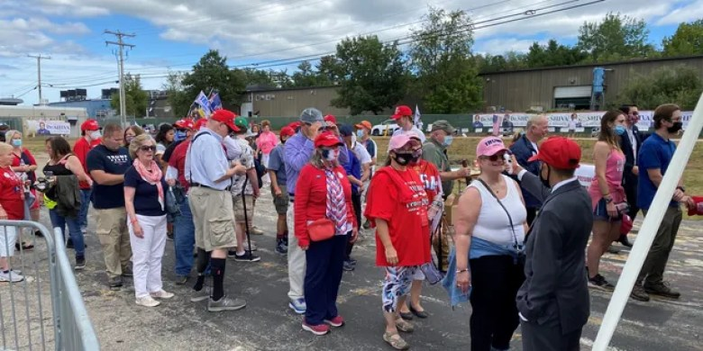 Supporters of President Trump wait in line for a temperature check before as they arrive for the president's speech in Manchester, New Hampshire, on Friday, August 28, 2020.