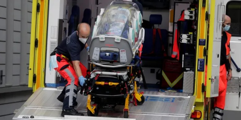 An empty stretcher is carried back into an ambulance that is believed to have transported Alexei Navalny at the emergency entrance of the Charite hospital in Berlin, Germany, on Saturday. (AP)